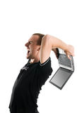 Anger. Men destroy a laptop stock images