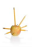 Anger. Pencils driven into a apple Stock Photo