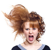 Anger. Portrait of the indignant young woman on the isolated white background.Strange hairdress. Anger stock photography