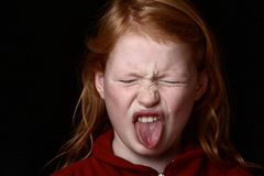 Anger. Angry young girl on black background Royalty Free Stock Images