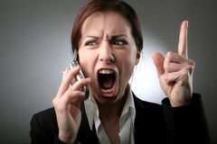 Anger 52. A woman screaming on the phone Stock Photography