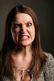 Anger. Young woman with anger face stock photo