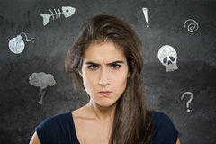 Anger. Angry woman is thinking about something Stock Photos