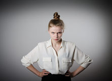 Anger. Angry young slim woman in white Royalty Free Stock Images