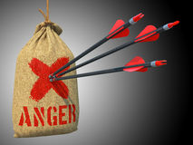 Anger - Arrows Hit in Red Mark Target. Anger -Three Arrows Hit in Red Mark Target on a Hanging Sack on Grey Background Royalty Free Stock Photography