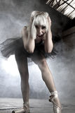 Anger, Artistic and sensual ballerina in an industry area, smoke Royalty Free Stock Photos