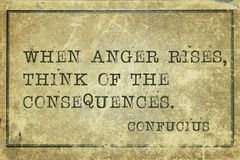 Anger Confucius. When anger rises - ancient Chinese philosopher Confucius quote printed on grunge vintage cardboard stock photos