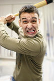 Anger and fury man. Man in fury with a baseball bat in hands royalty free stock image