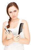 Anger hairdresser holding a  scissors and comb isolated (focus o Stock Photography