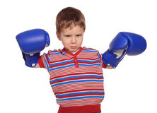Anger little boy with boxing gloves Royalty Free Stock Photos