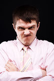 Anger man. In pink shirt at black background stock images