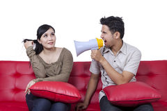 Anger man scolding his wife. Portrait of young men using a megaphone to scold his wife Stock Photography