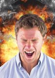 Anger man shouting with steam on ears and fire behind him. Stock Images