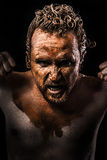 Anger man, Warrior young covered in mud Stock Photos