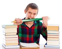 Anger Management. Nervous student biting his pencil in his anger stock images