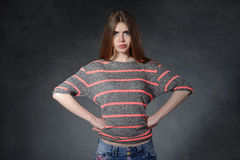 Anger side, a charge concept. Woman standing with hands on hips Royalty Free Stock Photo