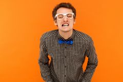 Anger stupid man looking at camera and showing funny face. Stock Image
