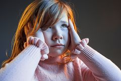 The anger and surprised teen girl. Hate, rage. Crying emotional angry teenager in colorful bright lights at studio background. Emotional face. Sport fan human Royalty Free Stock Images