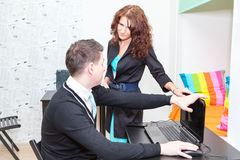 Anger woman closing laptop for stopping playing game online Royalty Free Stock Image