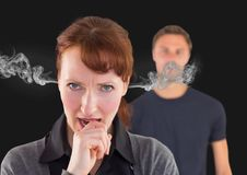 Anger woman with hand on mouth and steam on ears., with blurred man behind. Digital composite of anger women with hand on mouth and steam on ears., with blurred stock images