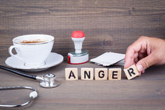 Anger. Wooden letters on dark background. Office desk Royalty Free Stock Images