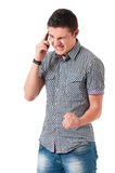 Anger young man with phone Stock Photos