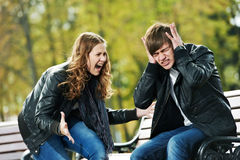 Anger in young people relationship conflict. Conflict in young people relationship. Furious anger girl and men stopped ears with hands stock photos