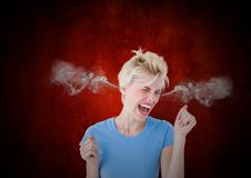 Anger young woman with steam on ears. Black and red background. Digital composite of anger young woman with steam on ears. Black and red background royalty free stock photos