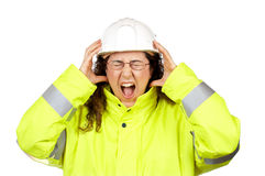 Angered female construction worker. Over a white background Stock Photography