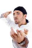 Angered male chef posing with karate. On an isolated white background Royalty Free Stock Photos