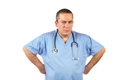 Angered male doctor. In blue scrubs blurred with stethoscope on white background Stock Photo