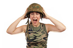 Angered soldier girl. Over a white background stock photos