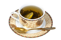 Angered by tea with lemon. Angered tea with lemon in a porcelain cup Royalty Free Stock Photography