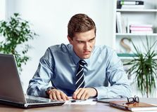 Angered worker with unhappy of facial expression. Photo of young man working in the office. Business concept Stock Image