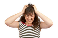 Angered young woman. Over a white background Stock Photos