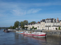 Angers, quai des Carmes, France, Europe. Docks, river Maine, Angers center in front of the medieval castle with white tuff buildings and barges Stock Images