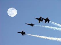 Anges bleus et pleine lune Photographie stock libre de droits