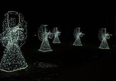 Anges de Noël sur un fond noir Fond Photographie stock libre de droits