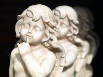 Anges en pierre de jardin Photos stock