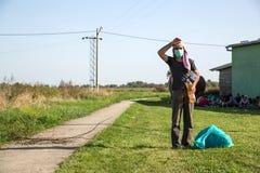 Angeschwemmter Flüchtling in Tovarnik Stockfotos