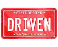 Angetriebenes Wort auf rotem Kfz-Kennzeichen Lizenzfreies Stockfoto