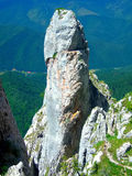 Rock tower in Piatra Craiului mountains Royalty Free Stock Photo