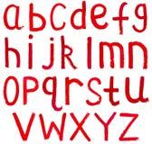 Angielscy lowercase listy pisać czerwoną farbą Obrazy Stock