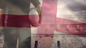 Angielski rugby gracz patrzeje stadium z Angielską flagą na przedpolu