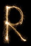 Angielszczyzny Piszą list R od sparklers abecadła na czarnym tle zdjęcie stock