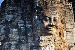 Angkor смотрит на в виске Bayon, Angkor Wat Стоковое Изображение RF