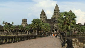 Angkor ancient temple in Cambodia. People walk by ancient temple in Angkor stock footage
