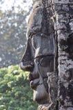 Angkor Bayon stone face profile Stock Images