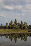 Angkor, Cambodia - December, 2015: Angkor Wat view. Picture taken at the entrance of Angkor Wat. The main monument is reflected on the water. Reflecting pool Royalty Free Stock Photo