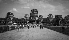 Angkor, Cambodia - December, 2015: People getting into Angkor Wat. Picture taken at the entrance of Angkor. People are getting into the complex Stock Image